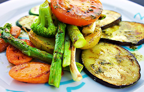 Season vegetables grilled